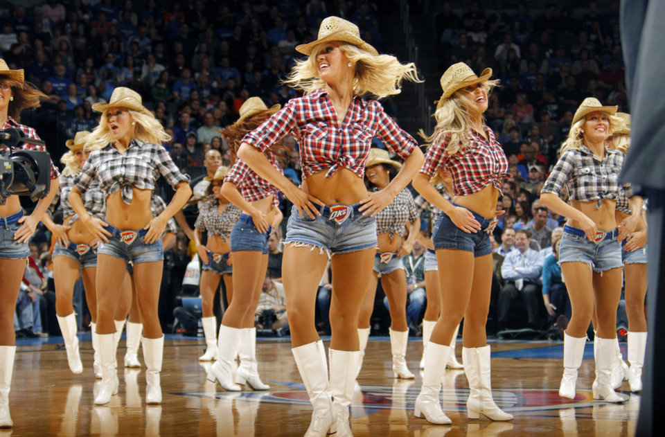 Photo - The Thunder Girls perform during the NBA basketball game between the Oklahoma City Thunder and the Los Angeles Clippers at Chesapeake Energy Arena on Wednesday, March 21, 2012 in Oklahoma City, Okla.  Photo by Chris Landsberger, The Oklahoman