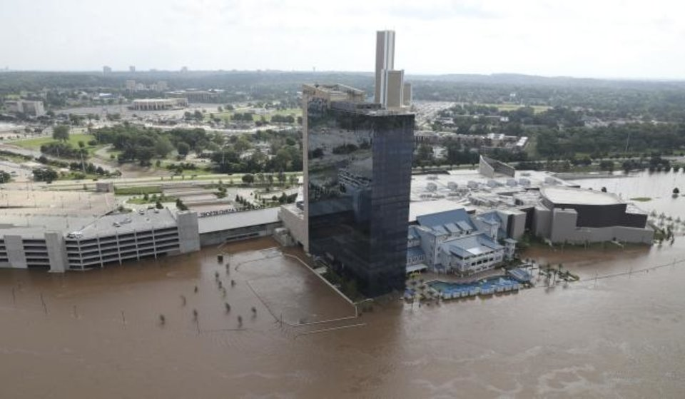 Photo -  The River Spirit Hotel and Casino has flood waters surrounding it Friday on the Arkansas River. [Tom Gilbert/Tulsa World]