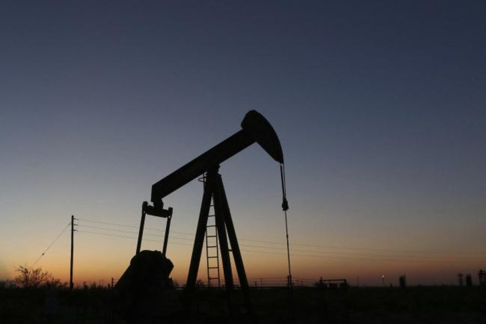 Photo -  A pump jack operates in an oil field in the Permian Basin in Texas. [AP PHOTO]