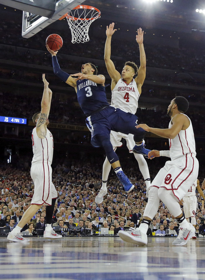 Photo - Villanova's Josh Hart (3) takes the ball to the hoop against, from left, Oklahoma's Ryan Spangler (00), Jamuni McNeace (4) and Jordan Woodard (10) during the national semifinal between the Oklahoma Sooners (OU) and the Villanova Wildcats in the Final Four of the NCAA Men's Basketball Championship at NRG Stadium in Houston, Saturday, April 2, 2016. Photo by Nate Billings, The Oklahoman