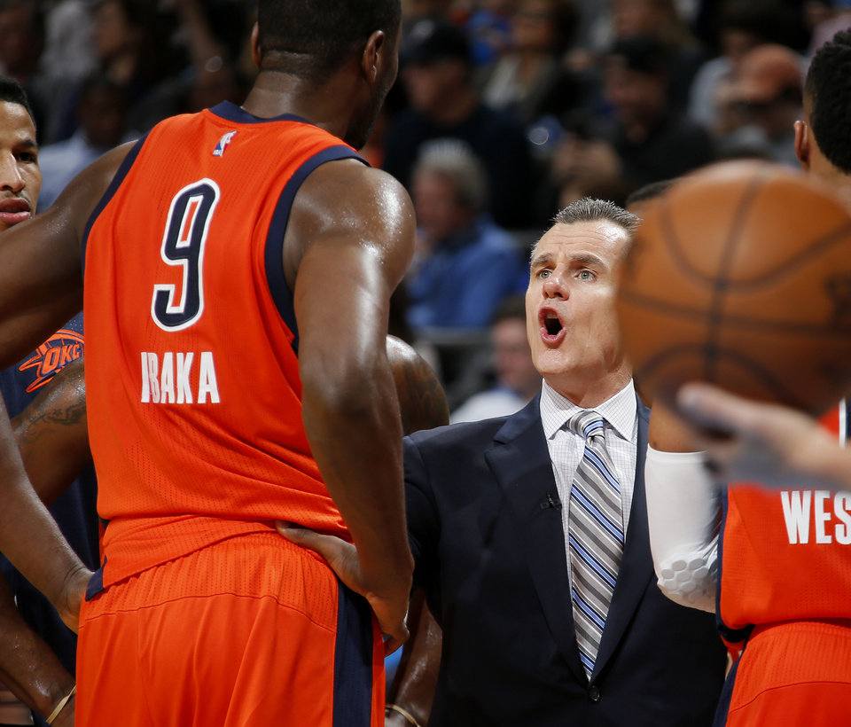 Photo - Oklahoma City coach Billy Donovan talks with Oklahoma City's Serge Ibaka (9) during an NBA basketball game between the Oklahoma City Thunder and the Cleveland Cavaliers at Chesapeake Energy Arena in Oklahoma City, Sunday, Feb. 21, 2016. Oklahoma City lost 115-92.  Photo by Bryan Terry, The Oklahoman