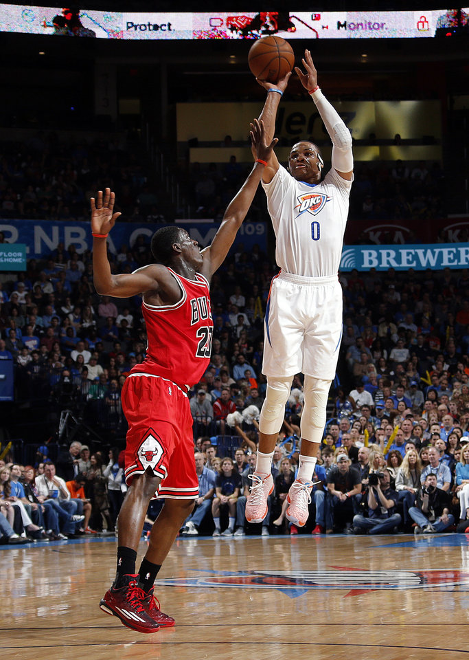 Photo - Oklahoma City's Russell Westbrook (0) shoots as Chicago's Tony Snell (20) defends during the NBA game between the Oklahoma City Thunder and the Chicago Bulls at Chesapeake Energy Arena in Oklahoma City, Sunday, March  15, 2015. Photo by Sarah Phipps, The Oklahoman