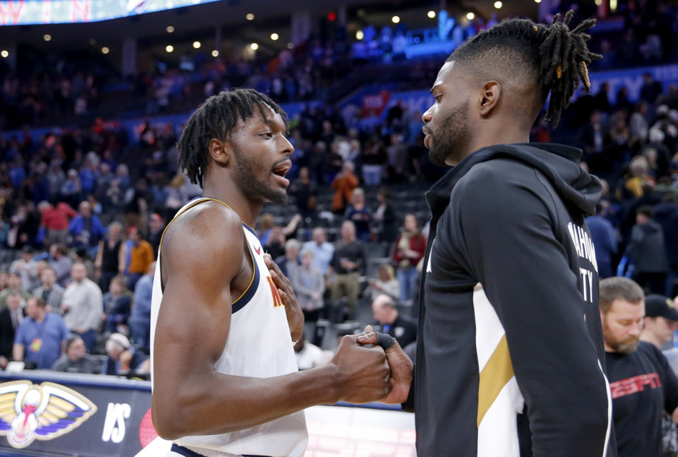 Photo - Oklahoma City's Nerlens Noel (9) greets Jerami Grant (9) following the NBA basketball game between the Oklahoma City Thunder and the Denver Nuggets at the Chesapeake Energy Arena in Oklahoma City,  Friday, Feb. 21, 2020.  [Sarah Phipps/The Oklahoman]