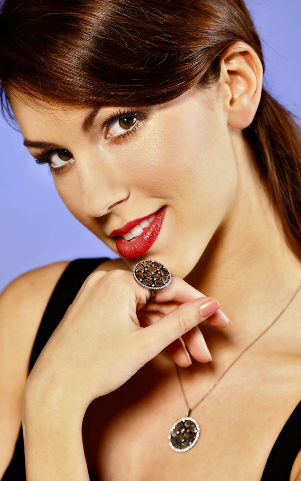 Photo - Raw diamond slices are featured in this pendant and ring, with a white diamond halo. Pendant and ring sold at BC Clark Jewelers. Model is Alexandra.Makeup by Shellie Pickens for The Makeup Bar.   Photo by Chris Landsberger, The Oklahoman.  CHRIS LANDSBERGER