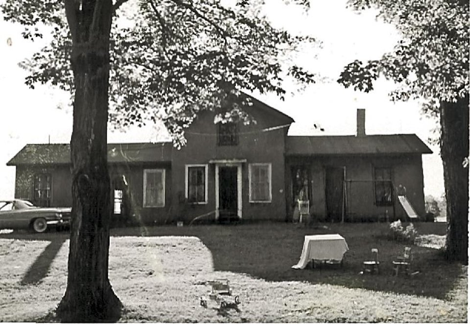 Photo - This undated photo of the house shows it without a porch. This must date back to my Dad's day, because he told me more than once about being chased by his older brother and jumping to safety from the second-story window to the ground.  Photo provided by Ken Raymond