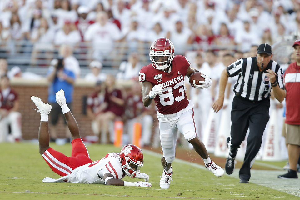 Photo - Oklahoma's Nick Basquine (83) runs past Houston's Ka'Darian Smith (16) after catching a pass during a college football game between the University of Oklahoma Sooners (OU) and the Houston Cougars at Gaylord Family-Oklahoma Memorial Stadium in Norman, Okla., Sunday, Sept. 1, 2019. [Bryan Terry/The Oklahoman]