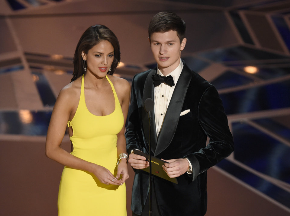 Photo - Eva Gonzalez, left, and Ansel Elgort present the award for best sound mixing at the Oscars on Sunday, March 4, 2018, at the Dolby Theatre in Los Angeles. (Photo by Chris Pizzello/Invision/AP)