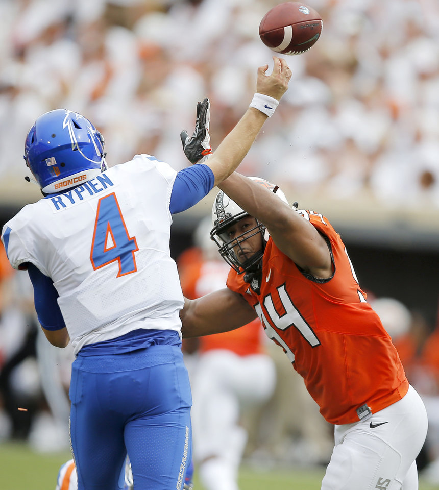 Photo - Oklahoma State's Jordan Brailford (94) puts pressure on Boise State's Brett Rypien (4) during a college football game between the Oklahoma State University Cowboys (OSU) and the Boise State Broncos at Boone Pickens Stadium in Stillwater, Okla., Saturday, Sept. 15, 2018. Oklahoma State won 44-21. Photo by Bryan Terry, The Oklahoman