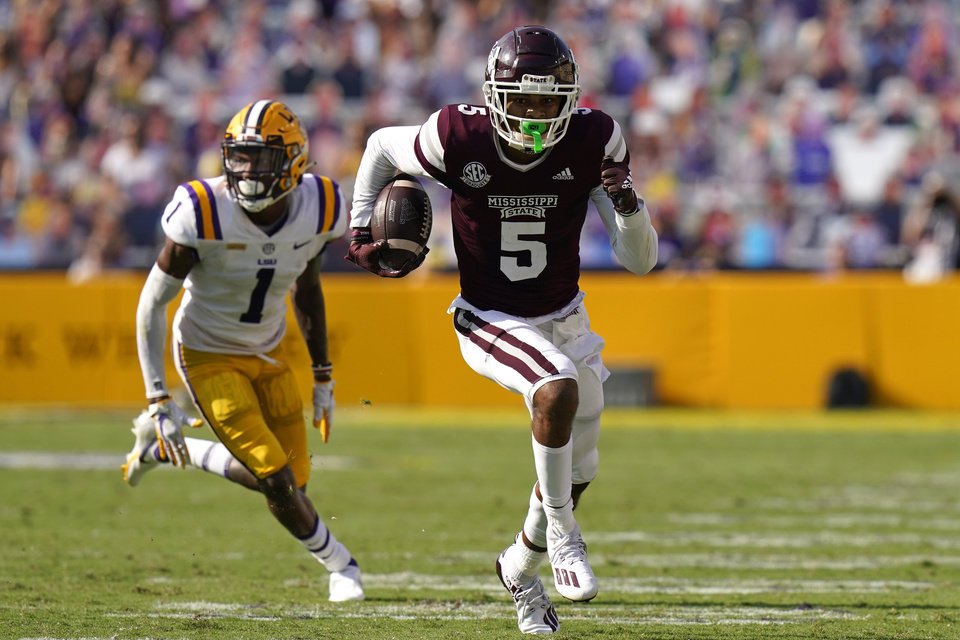 Photo - Mississippi State wide receiver Osirus Mitchell (5) carries on a touchdown reception as he is pursued by LSU cornerback Eli Ricks (1) in the first half an NCAA college football game in Baton Rouge, La., Saturday, Sept. 26, 2020. Mississippi State won 44-34. (AP Photo/Gerald Herbert)