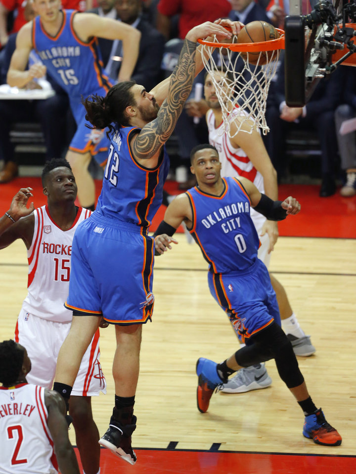 Photo - Oklahoma City's Steven Adams (12) dunks the ball in front of Houston's Clint Capela (15)  as Russell Westbrook (0) watches during Game 2 in the first round of the NBA basketball playoffs between the Oklahoma City Thunder and the Houston Rockets at the Toyota Center in Houston, Texas,  Wednesday, April 19, 2017.  Photo by Sarah Phipps, The Oklahoman