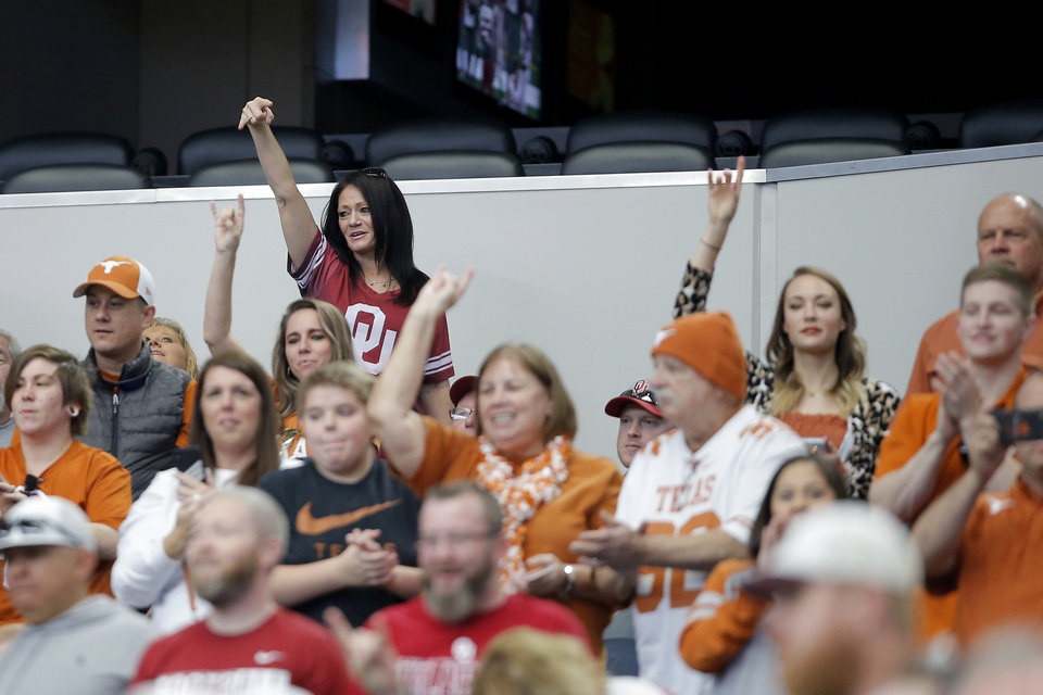"Photo - An Oklahoma fan gives the ""Horns Down"" hand gesture before the Big 12 Championship football game between the Oklahoma Sooners (OU) and the Texas Longhorns (UT) at AT&T Stadium in Arlington, Texas, Saturday, Dec. 1, 2018.  Photo by Bryan Terry, The Oklahoman"