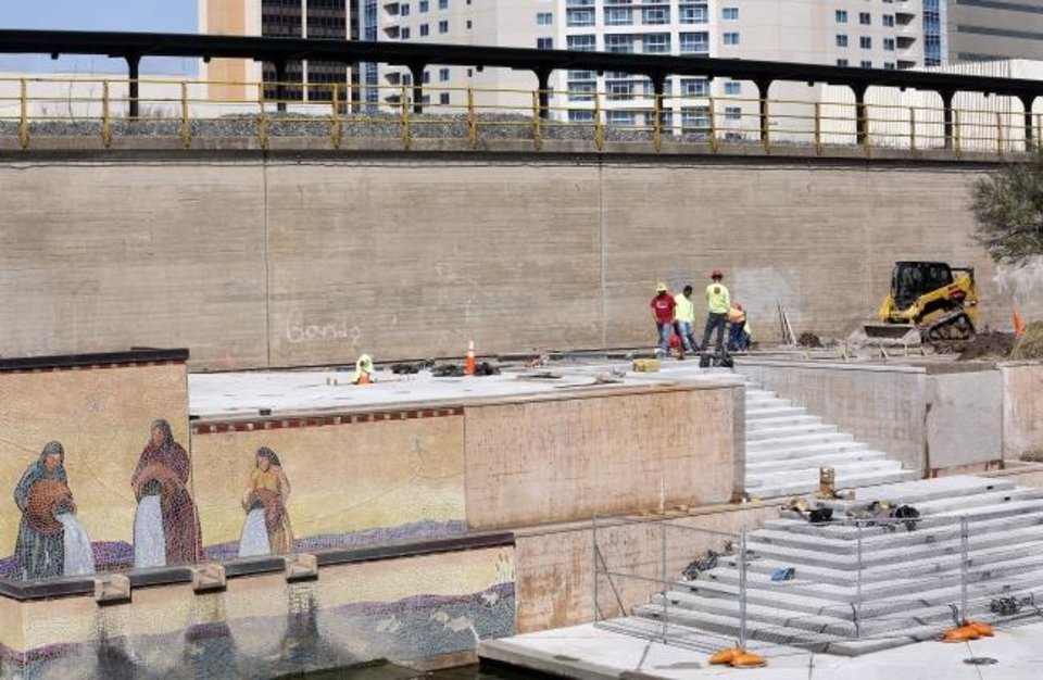 Photo -  Work continues on a stairway that will provide pedestrians visiting the Bricktown Canal from Sheridan and Reno Avenues a direct path to the lower level of the waterway. [Jim Beckel/The Oklahoman]