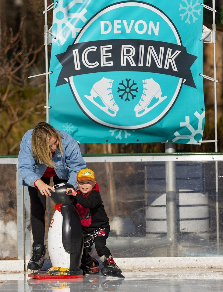 Photo - Emma Petry helps her son Troy, 4, as they try to keep their footing on the ice while skating at the Devon Ice Rink in Oklahoma City, Okla. on Wednesday, Jan. 1, 2020. [Chris Landsberger/The Oklahoman Archives]