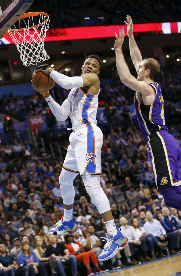 Photo - Oklahoma City's Russell Westbrook (0) grabs a rebound in front of Los Angeles' Alex Caruso (4) in the fourth quarter during an NBA basketball game between the Los Angeles Lakers and the Oklahoma City Thunder at Chesapeake Energy Arena in Oklahoma City, Tuesday, April 2, 2019. Oklahoma City won 119-103. Photo by Nate Billings, The Oklahoman
