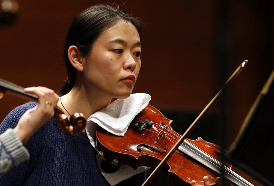 Photo - Violinist Cindy Zhang rehearses with the Oklahoma City Philharmonic Orchestra on Thursday, Feb. 1, 2018 in Oklahoma City, Okla. [The Oklahoman Archives photo]
