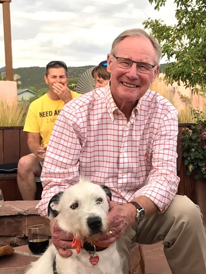 Photo - Burns Hargis with his dog, Scruff. Scruff is a member of Oklahoma State University's Pete's Pet Posse. PHOTO PROVIDED