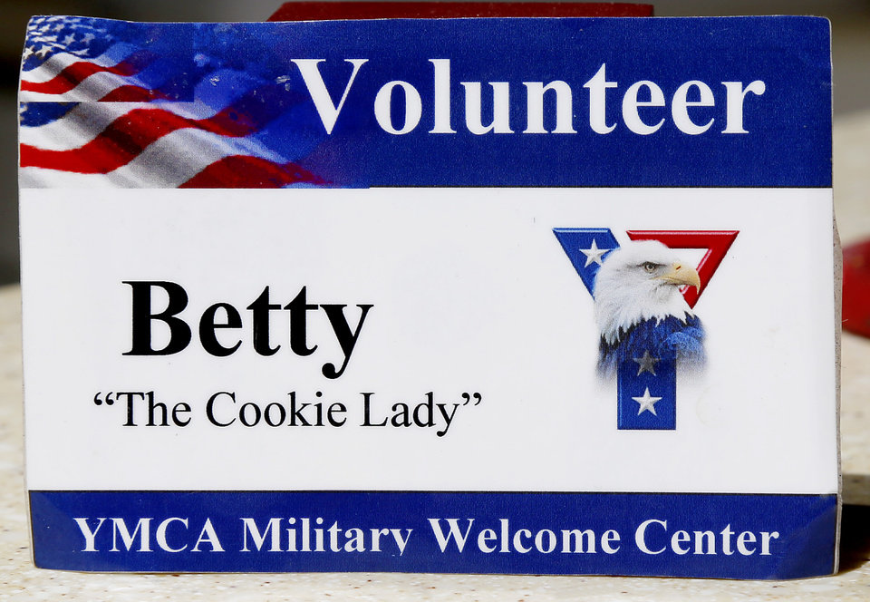 Photo -  Betty Hulson wears this badge when she volunteers at the YMCA Military Welcome Center at Will Rogers World Airport. [Photo by Jim Beckel, The Oklahoman]