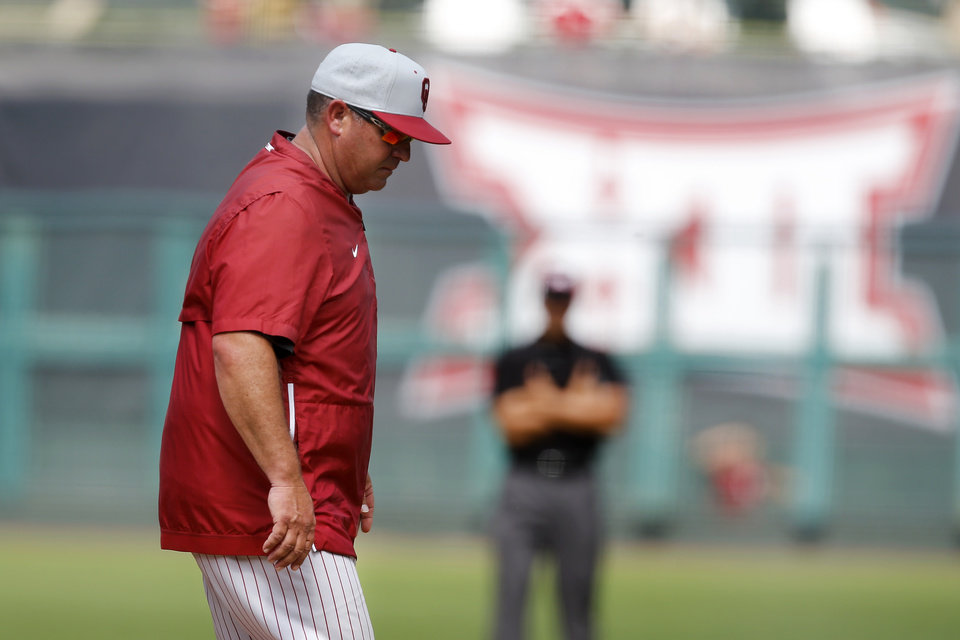 Photo - Oklahoma coach Skip Johnson walks to the dugout after a pitching change during a Big 12 baseball tournament game between the University of Oklahoma (OU) and TCU at Chickasaw Bricktown Ballpark in Oklahoma City, Okla., Thursday, May 23, 2019.  [Bryan Terry/The Oklahoman]