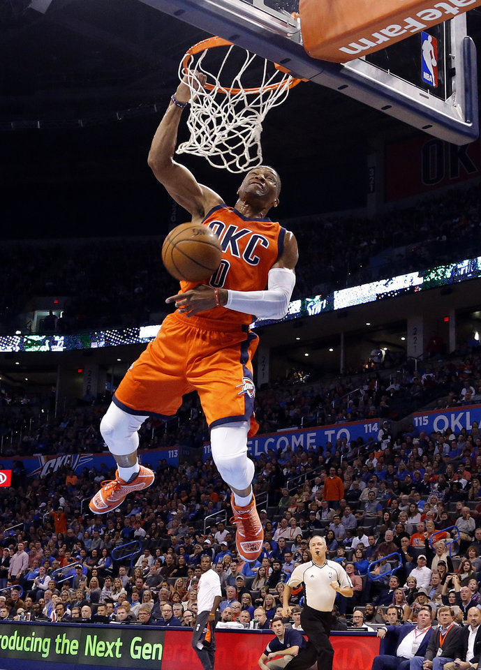 4bd546dae524 Oklahoma City s Russell Westbrook (0) dunks during the NBA basketball game  between the Oklahoma