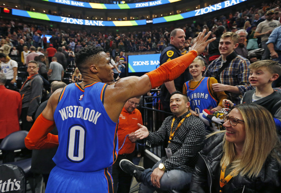 Photo - Oklahoma City Thunder guard Russell Westbrook (0) waves to the crowd as he leaves the court following an NBA basketball game against the Utah Jazz, Monday, March 11, 2019, in Kearns, Utah. (AP Photo/Rick Bowmer)