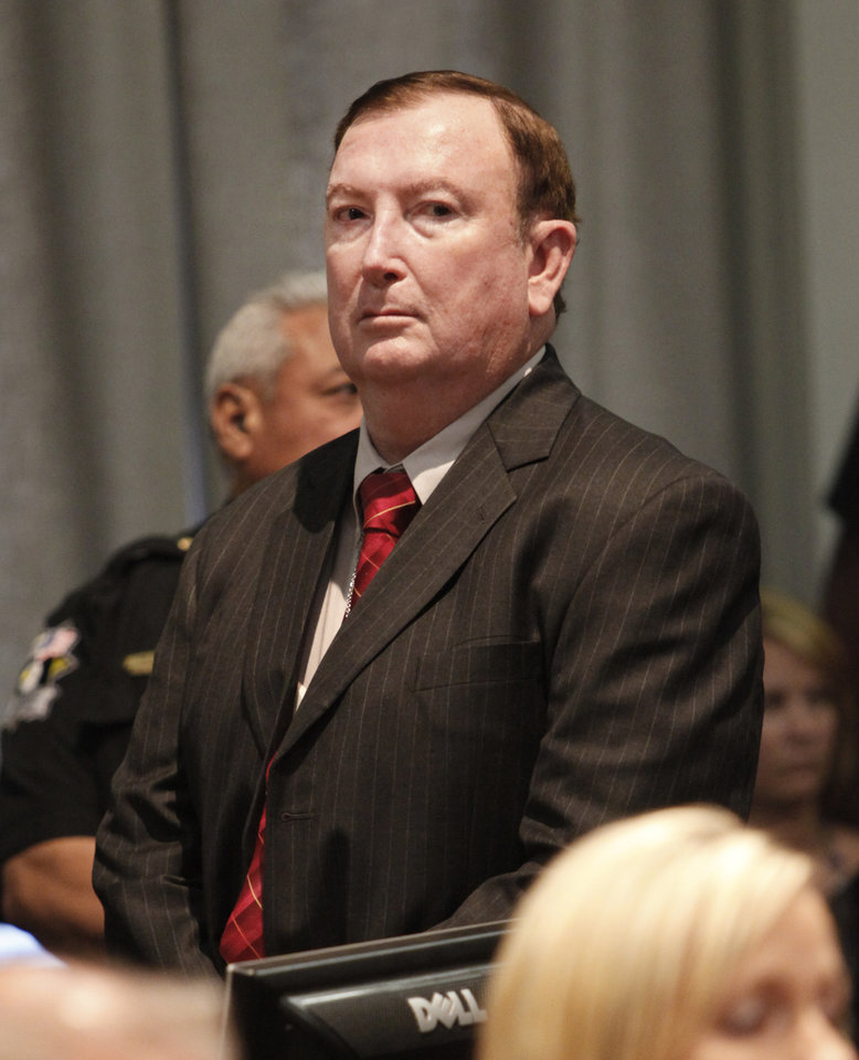 Photo - Jerome Ersland stands as his guilty verdict is read by Judge Ray C. Elliott in Oklahoma City, Oklahoma , Thursday, May 26, 2011. Photo by Steve Gooch, Pool/ The Oklahoman