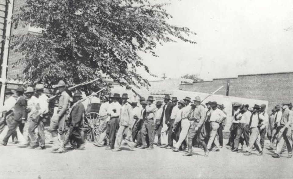 Photo -  National Guard soldiers march African American men down a street during the Tulsa Race Massacre, June 1, 1921. [Oklahoma Historical Society Photograph Collection, OHS]