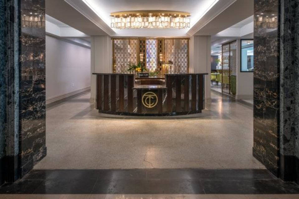 Photo -  The lobby desk at the 90-room Hilton Curio Hotel. The building originally was the Tulsa Club. [PROVIDED BY THE ROSS GROUP]