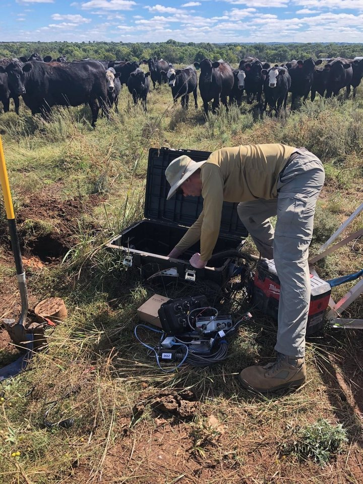 Photo -  Andrew Thiel, a seismic analyst at the Oklahoma Geological Survey, installs a seismometer near Ralston. [Photo provided by Oklahoma Geological Survey]