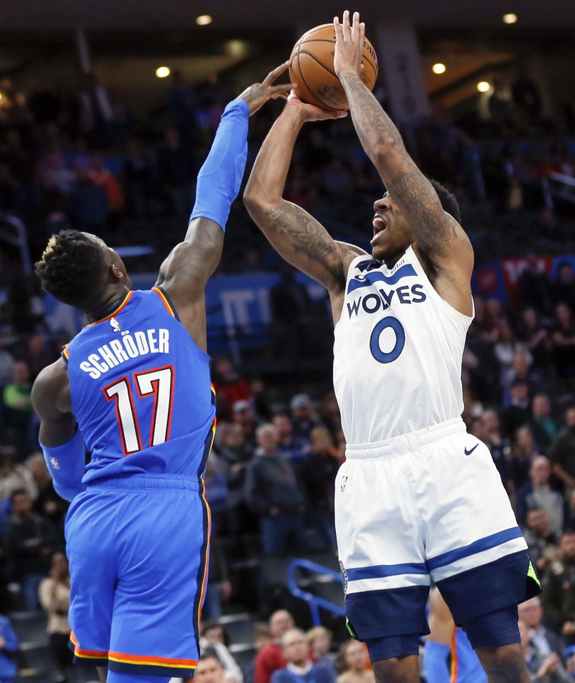 Photo - Oklahoma City's Dennis Schroder (17) blocks a shot by Minnesota's Jeff Teague (0) during overtime of an NBA basketball game between the Minnesota Timberwolves and the Oklahoma City Thunder at Chesapeake Energy Arena in Oklahoma City, Friday, Dec. 6, 2019. Oklahoma City won 139-127 in overtime. [Nate Billings/The Oklahoman]