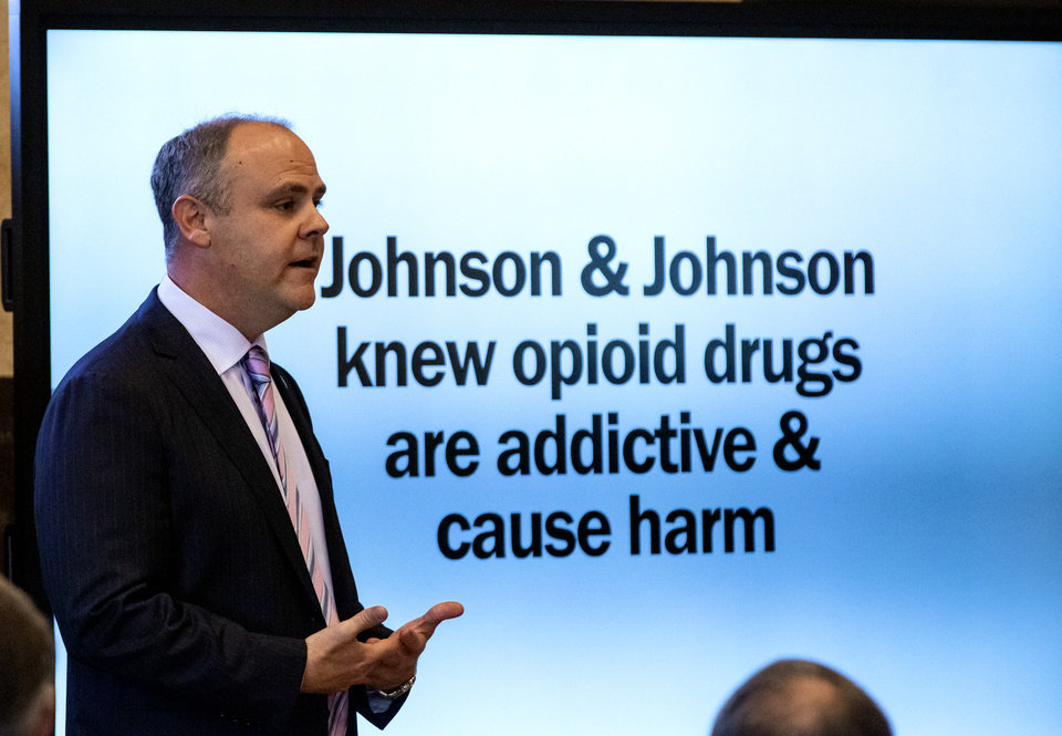 Photo - State's attorney Brad Beckworth presents information in the opening statements during the opioid trial at the Cleveland County Courthouse in Norman, Okla. on Tuesday, May 28, 2019. The proceeding are the first public trial to emerge from roughly 2,000 U.S. lawsuits aimed at holding drug companies accountable for the nationÕs opioid crisis.  [Chris Landsberger/The Oklahoman]