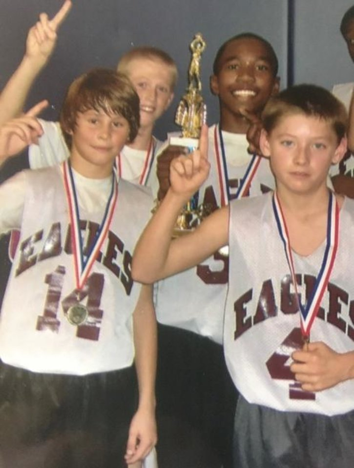 Photo -  Brady Manek (back left) and Kristian Doolittle (back right) won plenty of games together before their OU days. [Photo provided by Cary Manek]