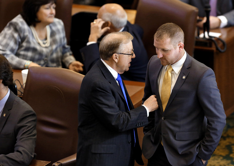 Photo - Rep. Earl Sears, left, speaks to a fellow lawmaker on the floor of the House before the start of the Oklahoma Legislature's 2016 State-of-the-State Address by Gov. Mary Fallin in the chamber of the House of Representatives at the Oklahoma state capitol on Monday, Feb. 1, 2016, in Oklahoma City, Okla. Photo by Jim Beckel, The Oklahoman
