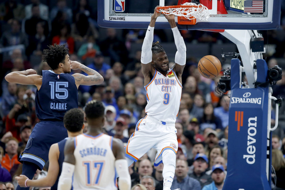 Photo - Oklahoma City's Nerlens Noel (9) dunks the ball during and NBA basketball game between the Oklahoma City Thunder an the Memphis Grizzlies at Chesapeake Energy Arena in Oklahoma City, Wednesday, Dec. 18, 2019. Oklahoma City won 126-122. [Bryan Terry/The Oklahoman]