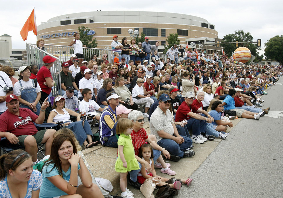 Photo - Spectators watch the Oklahoma Centennial Parade from the front of the Ford Center in downtown Oklahoma City, Okla., Sunday, October 14, 2007. Photo by Paul Hellstern / The Oklahoman.