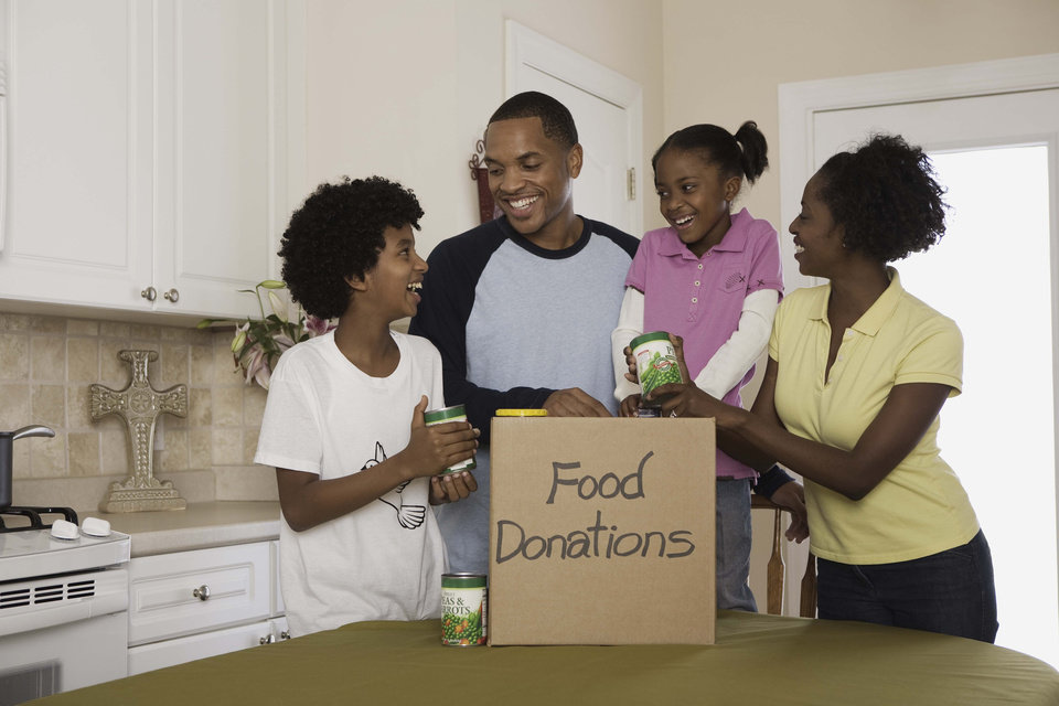 Photo -  Families can work together to volunteer and help make a difference in the lives of those affected by child poverty. [THINKSTOCK PHOTO]