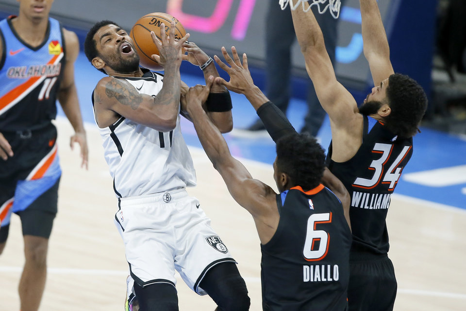 Photo - Brooklyn's Kyrie Irving (11) is fouled by Oklahoma City's Hamidou Diallo (6) during an NBA basketball game between the Oklahoma City Thunder and the Brooklyn Nets at Chesapeake Energy Arena in Oklahoma City, Friday, Jan. 29, 2021. [Bryan Terry/The Oklahoman]