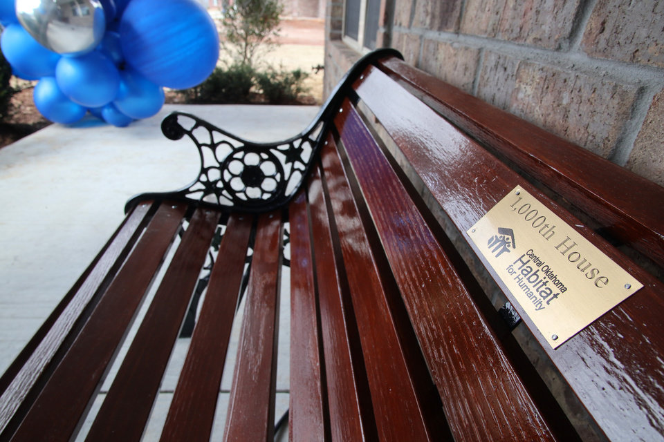 Photo - Bench on front porch. Habitat for Humanity's 1,000th home, Monday, March 9, 2020.  [Photo by Doug Hoke/The Oklahoman]