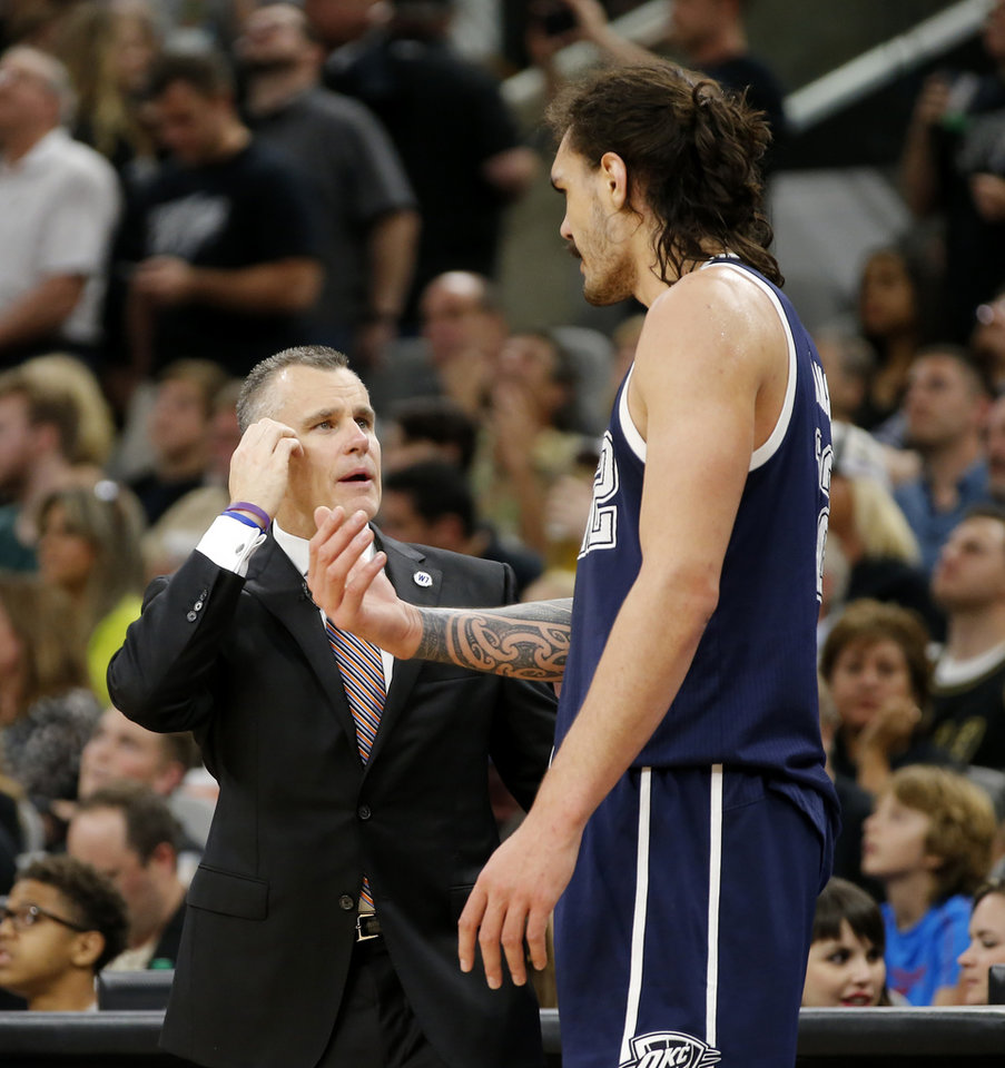 Photo - Oklahoma City coach Billy Donovan talks with Steven Adams (12) during Game 1 of the second-round series between the Oklahoma City Thunder and the San Antonio Spurs in the NBA playoffs at the AT&T Center in San Antonio, Saturday, April 30, 2016. San Antonio won 124-92. Photo by Bryan Terry, The Oklahoman