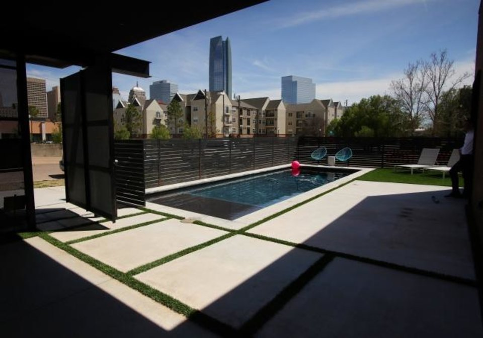 Photo -  View from the covered patio looking to the pool and downtown at the Brett and Leighann Price home at 511 N Dewey Ave. [DOUG HOKE/THE OKLAHOMAN]