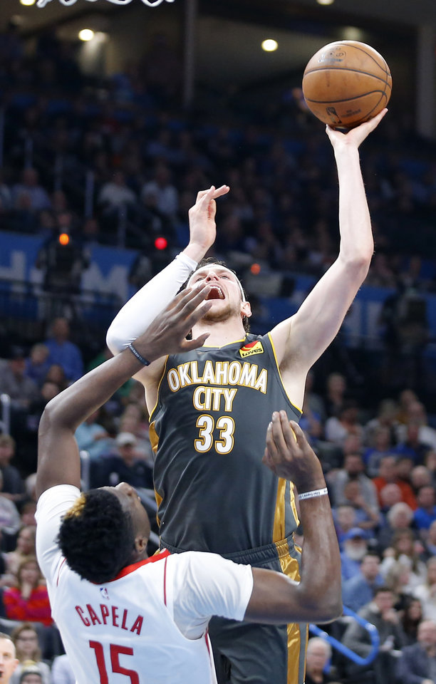 Photo - Oklahoma City's Mike Muscala (33) takes a shot as Houston's Clint Capela (15) during an NBA basketball game between the Oklahoma City Thunder and Houston Rockets at Chesapeake Energy Arena in Oklahoma City, Thursday, Jan. 9, 2020. [Bryan Terry/The Oklahoman]
