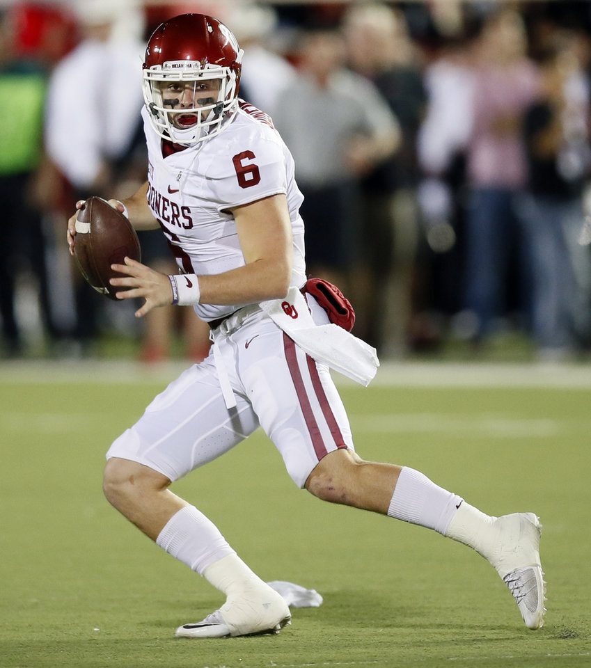 Photo -  Oklahoma's Baker Mayfield (6) scrambles in the second quarter during a college football game between the University of Oklahoma Sooners (OU) and Texas Tech Red Raiders at Jones AT&T Stadium in Lubbock, Texas, Saturday, Oct. 22, 2016. Photo by Nate Billings, The Oklahoman