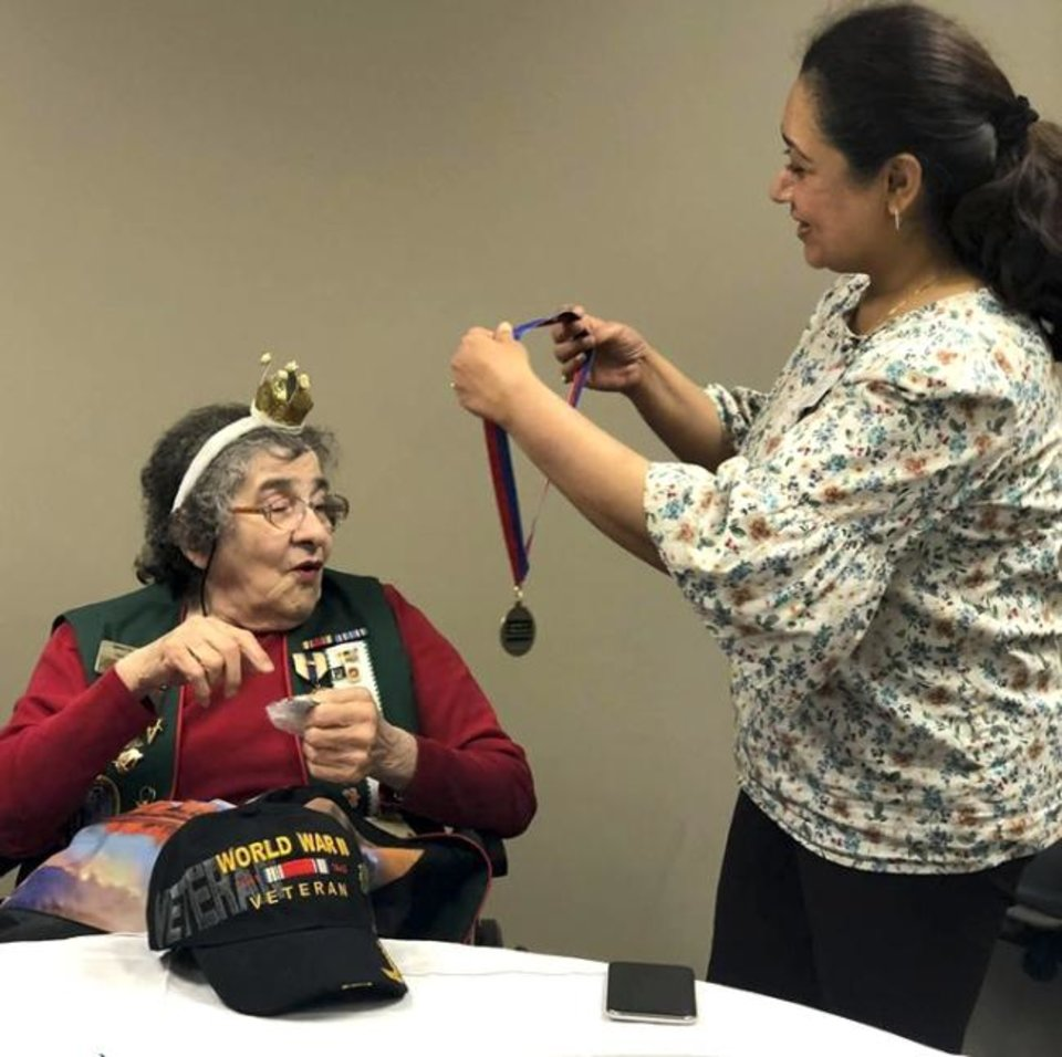 Photo -  Mary Glann was awarded a VA challenge coin and medal by Ishita Thakar, director of women's health and women's program manager at the Oklahoma City VA Healthcare System Women's Clinic. [PHOTO PROVIDED]