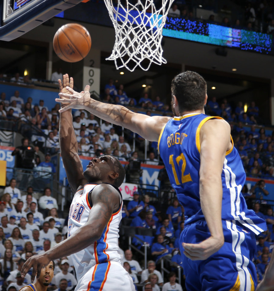 Photo - Dion Waiters (3)t goes t the basket past Golden State's Andrew Bogut (12) during Game 3 of the Western Conference finals in the NBA playoffs between the Oklahoma City Thunder and the Golden State Warriors at Chesapeake Energy Arena in Oklahoma City, Sunday, May 22, 2016. Photo by Bryan Terry, The Oklahoman