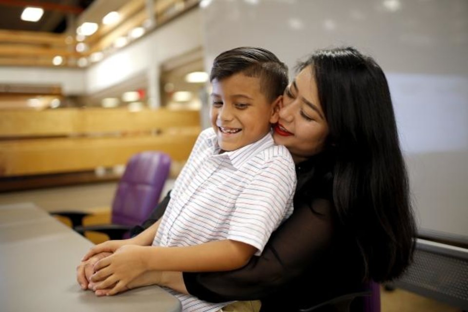 Photo -  Rosaura Teus poses for a photograph with her son, Elijah Teus, 8, at Oklahoma City Community College. [Sarah Phipps/The Oklahoman]
