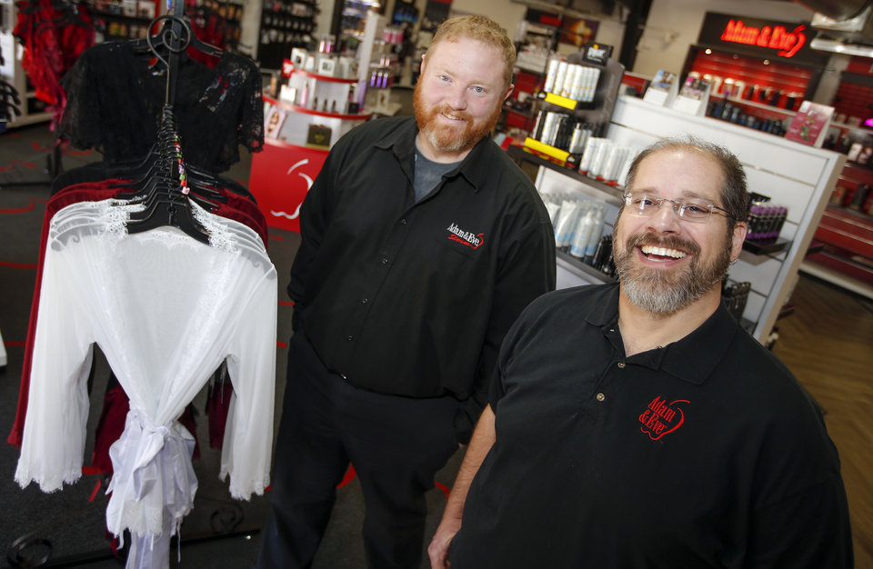Photo -  Andrew Ryerson-Gonzalez, left, and Lennox Ryerson-Gonzalez say many retailers today carry products that once were found only in edgy sex shops. Their Adam & Eve store is part of a trend in upscale shopping choices for adults. [Photo by Nate Billings, The Oklahoman]