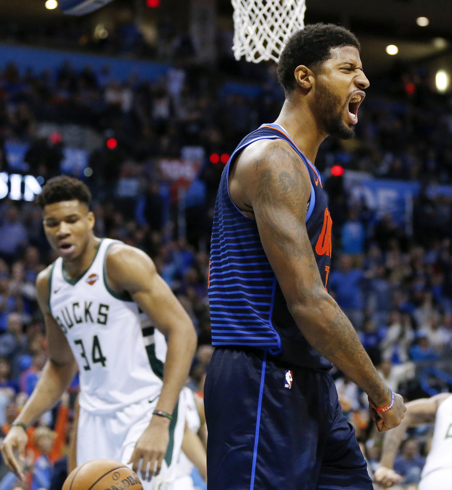 Photo - Oklahoma City's Paul George (13) reacts after dunking on Milwaukee's Giannis Antetokounmpo (34) in the fourth quarter during an NBA basketball game between the Milwaukee Bucks and the Oklahoma City Thunder at Chesapeake Energy Arena in Oklahoma City, Sunday, Jan. 27, 2019. Oklahoma City won 118-112. Photo by Nate Billings, The Oklahoman