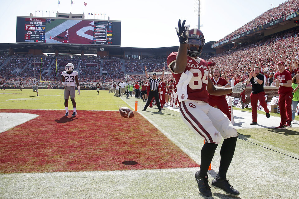 Photo - Oklahoma's Lee Morris (84) celebrates after scoring a touchdown during a college football game between the University of Oklahoma Sooners (OU) and the West Virginia Mountaineers at Gaylord Family-Oklahoma Memorial Stadium in Norman, Okla, Saturday, Oct. 19, 2019. Oklahoma won 52-14. [Bryan Terry/The Oklahoman]