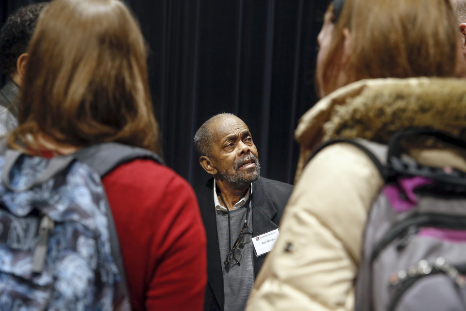 Photo - Ron Wright talks with people who attended a panel discussion with former students who were expelled from then Oklahoma Christian College and arrested in 1969 after the Benson Hall sit-in to protest the expulsion of black basketball players who were accused of attending an interracial gathering off campus, at Oklahoma Christian University's Judd Theatre in Oklahoma City, Wednesday, March 6, 2019. Wright is one of what OC now calls Oklahoma Christian's 18. Photo by Nate Billings, The Oklahoman