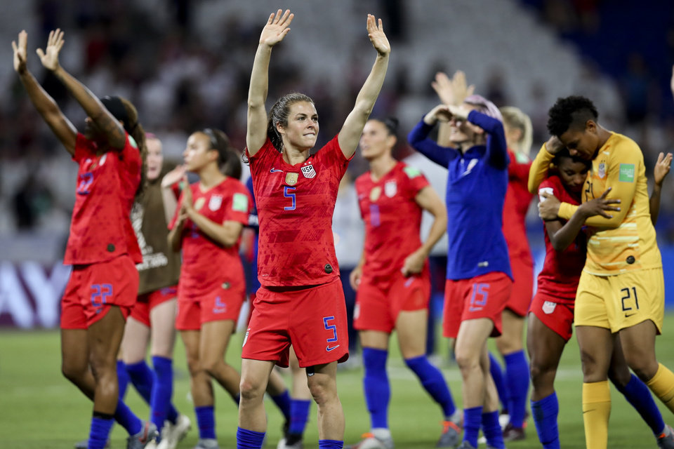 Photo - United States' players celebrate their victory against England after the Women's World Cup semifinal soccer match at the Stade de Lyon outside Lyon, France, Tuesday, July 2, 2019. (AP Photo/Francisco Seco)