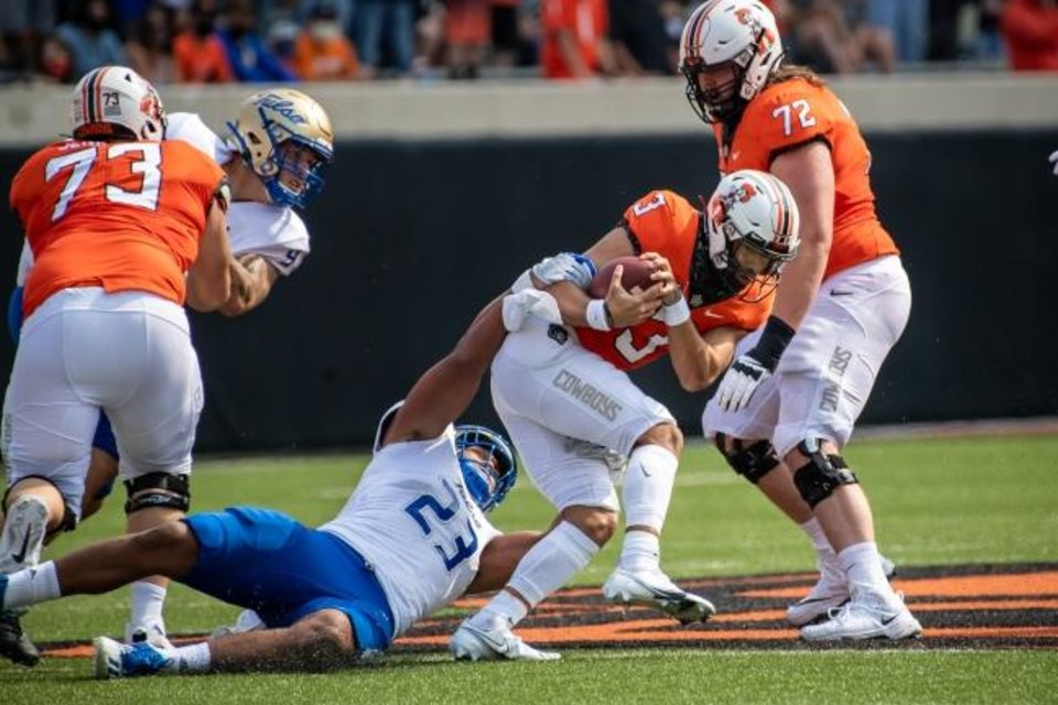 Photo -  Tulsa linebacker Zaven Collins (23) sacks OSU quarterback Spencer Sanders (3) in the first half Saturday in Stillwater. [Rob Ferguson/USA TODAY Sports]